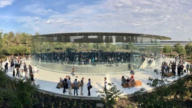 The Steve Jobs Theatre at Apple Park, with the glass-encircled waiting room at ground level, theatre beneath and the ...
