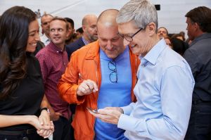 Apple's Tim Cook and Jony Ive look at the new iPhone X. Cook says he has put boundaries on his nephew using social media.
