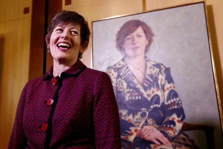 Former speaker Anna Burke stands before her portrait, painted by Jude Rae, at Parliament House in Canberra on Thursday.