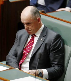 Liberal MP Stuart Robert takes his seat after denying any wrongdoing.