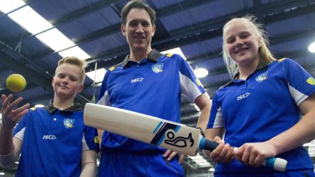 Cricket Australia CEO James Sutherland with Lauren Phillips (15) and Matt Phillips (12) in Canberra during Play Cricket Week.
