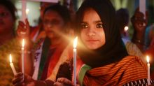 Activists hold lighted candles during a protest in Mumbai in 2015 over the release of a juvenile convicted in the 2012 ...