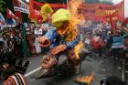 Protesters burn an effigy of U.S. President Donald Trump riding on a missile with an image of Philippine President ...