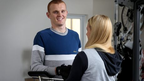 Anger is gone: Knights physio Pip Cave helps Alex McKinnon with his rehab.