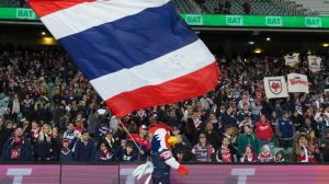 New South Wales's team? Not quite: Sydney Roosters fans after their win over the Broncos.