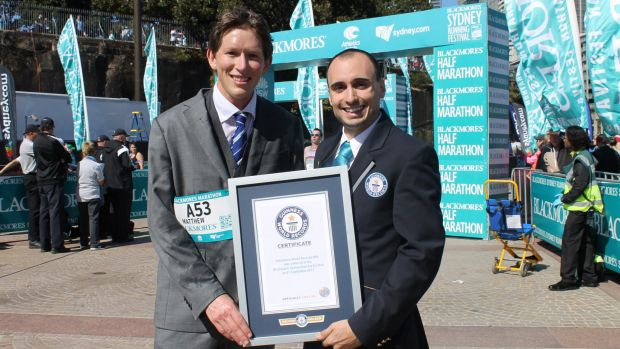 Matthew Whitaker with his Guinness World Record certificate after completing the Sydney Running Festival marathon ...