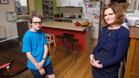 Fran Cusworth with her 12-year-old son Redmond. Fran let out her family's Melbourne home on Airbnb to help cover the ...
