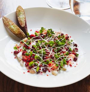 Raw kingfish with coconut cream and pomegranate.