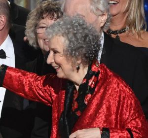 """Elisabeth Moss, left, and author Margaret Atwood embrace as """"The Handmaid's Tale"""" wins the award for outstanding drama ..."""