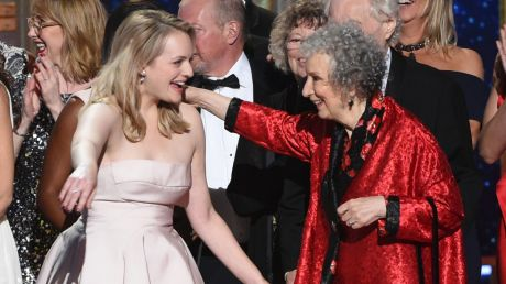 "Elisabeth Moss, left, and author Margaret Atwood embrace as ""The Handmaid's Tale"" wins the award for outstanding drama ..."