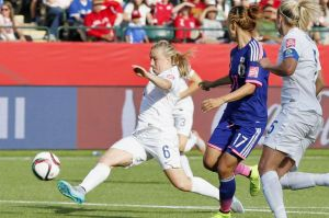 England defender Laura Bassett (6) tries to block a pass during the second half of a Women's World Cup semifinal against ...