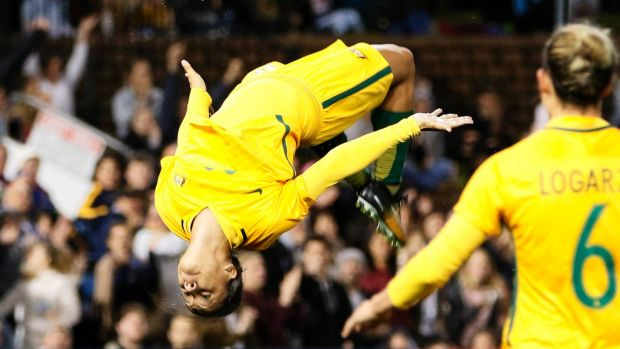 Kerr does a trademark backflip after scoring a goal during the Matildas' 3-2 defeat of Brazil in Newcastle in September.