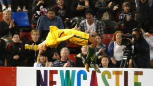 Australia's Sam Kerr does a backflip to celebrate scoring against Brazil during their friendly soccer match in ...