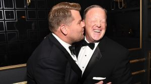 James Corden has sort of apologised for his controversial kiss with Sean Spicer at Monday's Emmy Awards.