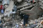 A construction worker searches a building that collapsed after an earthquake, in the Roma neighborhood of Mexico City, ...