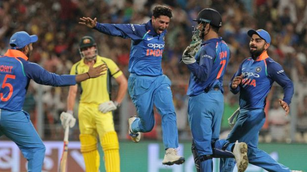 India's Kuldeep Yadav celebrates after taking his third wicket.