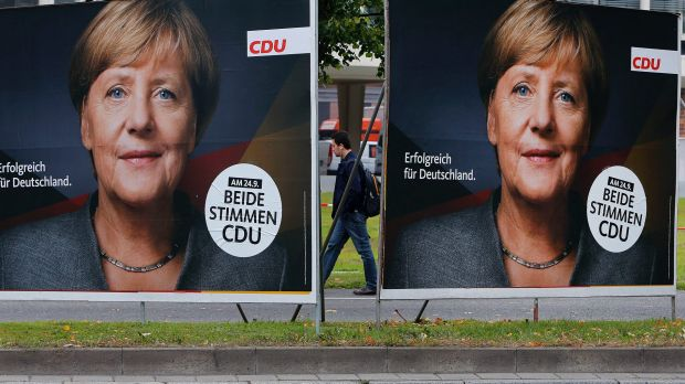 Election posters of German Chancellor Angela Merkel stand at a main street in Frankfurt.