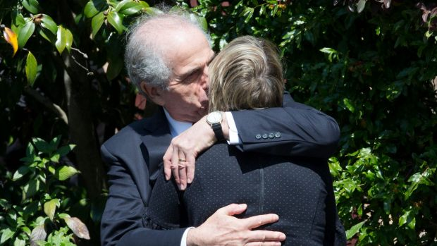 Siblings Garth Symonds and Anna Cleary console each other after the funeral of their mother, Lady (Mary) Fairfax.