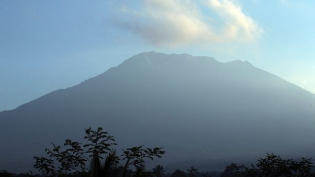 1,44000 flee as Bali volcano spew steam and sulphurous fumes