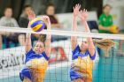 Canberra's Georgia Niedermeier and Tess Barbour successfully block a UTSSU Shield spike.