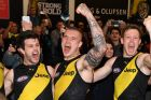 rent Cotchin, Dustin Martin and Jack Riewoldt of the Tigers react after winning