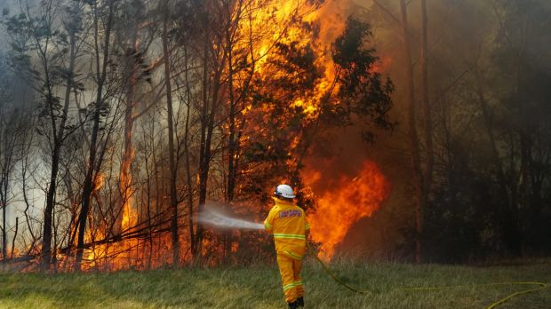 An out-of-control bushfire is threatening homes in Nowra.