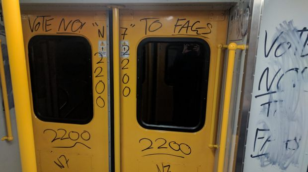 "A train vandalised in Sydney with ""vote no"" graffiti."
