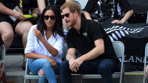 Prince Harry and his girlfriend Meghan Markle attend a wheelchair tennis event at the Invictus Games in Toronto, Monday, ...