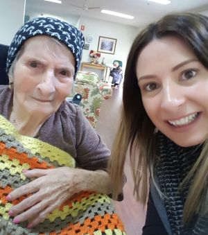 Nanna with one of her grandchildren, Stephanie, the author's sister, in September last year ... a very different face ...