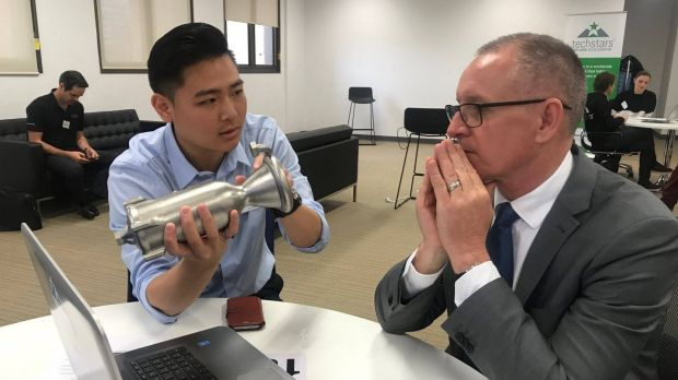 Andy Kieatiwong explains his next generation rockets to South Australian premier Jay Weatherill at TechStars in Adelaide.