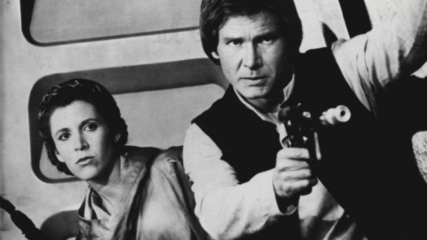 Carrie Fisher as Leia and Harrison Ford as Han Solo.