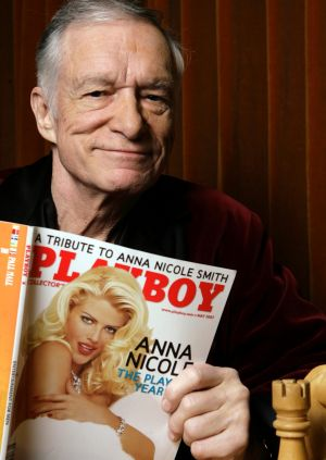 Hugh Hefner poses for a photo at the Playboy Mansion in Los Angeles.