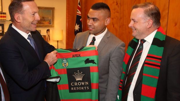 Politics mixing with sport: The then prime minister Tony Abbott was presented with a South Sydney jersey alongside ALP ...