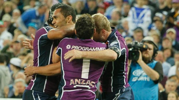 Grand final glory Justin O'Neill and the Storm celebrate the centre's try against Canterbury in 2012