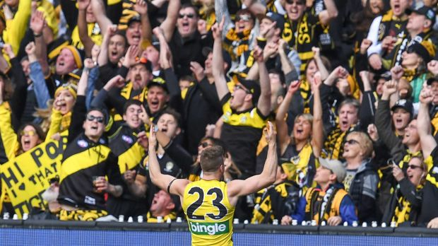 Kane Lambert celebrates with the crowd during the 2017 grand final at the MCG.
