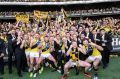The drought has broken - Richmond celebrate their grand final win over Adelaide.