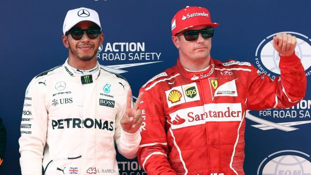 Top two: Lewis Hamilton with poses Kimi Raikkonen after taking pole position.