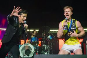 Jack Riewoldt and Brandon Flowers on stage after the grand final.