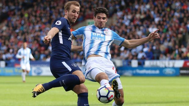 One-sided: Harry Kane and Christopher Schindler battle for the ball at the John Smith's Stadium, Huddersfield.