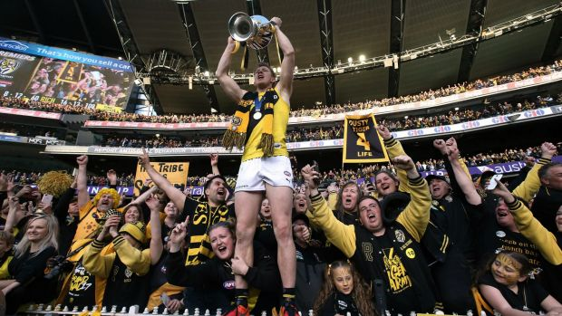 Jack Riewoldt celebrates Richmond's premiership with the Tigers' cheer squad.