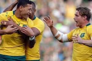 Australia's Israel Folau, left, celebrates with teammates after scoring a try during the Rugby Championship match ...