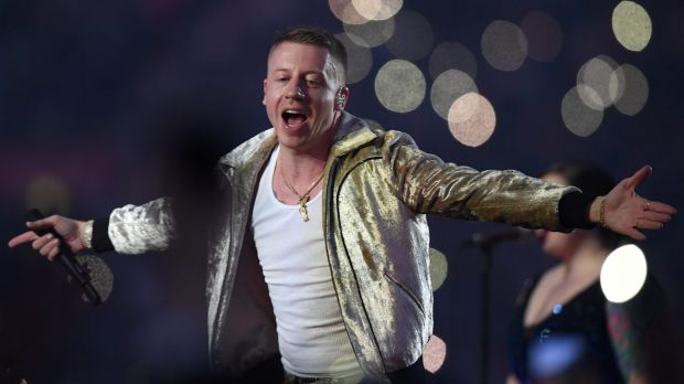 US artist Macklemore sang to rapturous applause from fans in the front row, the stands at ANZ Stadium and on social media.