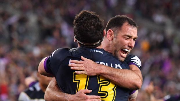Storm stars Dale Finucane and Cameron Smith celebrate after a deft pass put Finucane over the try line