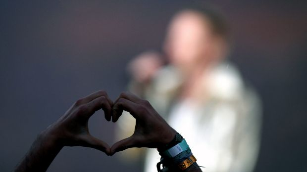 Those in the crowd waved rainbow flags and made love heart symbols with their hands.