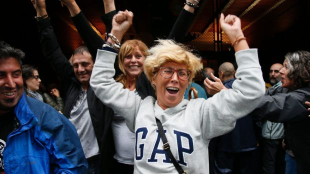 A woman cheers after casting her vote in the Catalan referendum in the Gracia neighbourhood of Barcelona.