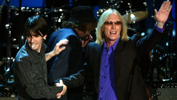 Tom Petty and Dhani Harrison, the son of the late George Harrison, perform at the Rock and Roll Hall of Fame Induction ...