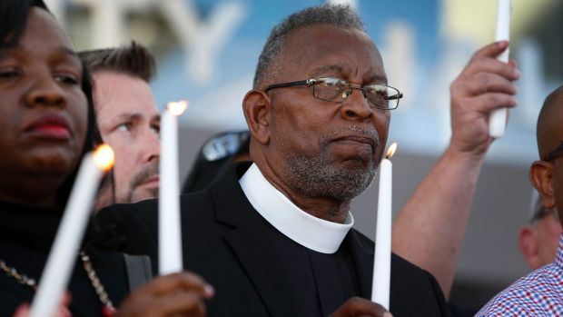 Pastor William McCurdy holds a candle during a prayer vigil in honour of those affected by the shooting on the Las Vegas ...