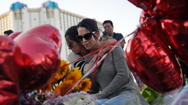 Christine Torres, right, and her daughter Sydney hug at a memorial for the shooting victims in Las Vegas on Tuesday.