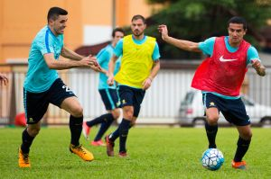 Tom Rogic and Tim Cahill. in Socceroos training in Malaysia before their World Cup qualifier first leg against Syria.