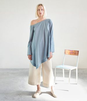 Asymmetrical top, $135, culottes, $135, and slip-on sneakers, $150.